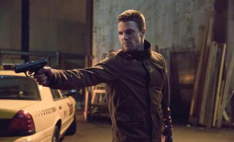 Oliver Aims a Gun