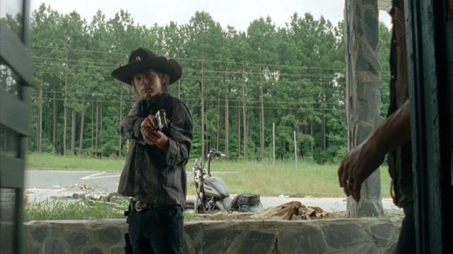 Carl Brandishes a Pistol