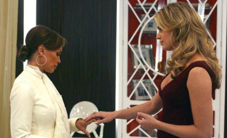 Wilhelmina Looks at Alexis' Hands