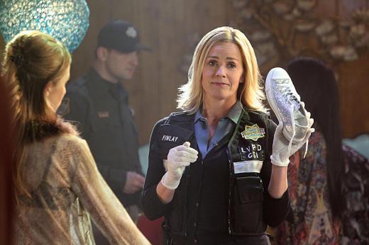 Elisabeth Shue with a Shoe