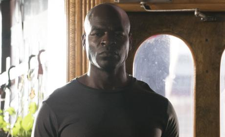 Dembe gives his best serious face - The Blacklist Season 4 Episode 1