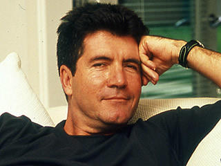 Cowell Sits Back