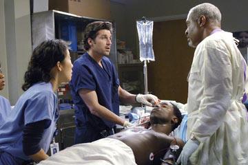 Derek and Richard Tend to Dr. Burke