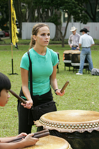 Caite Bangs the Drum