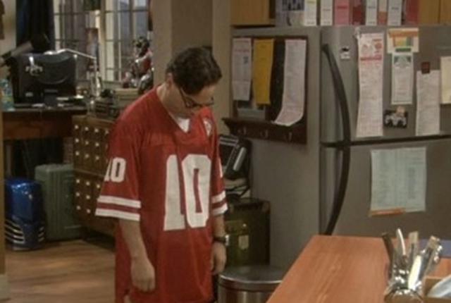 Leonard in football jersey