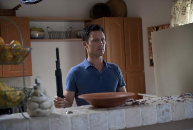 In the kitchen with a shotgun