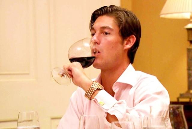 Thomas drinks wine