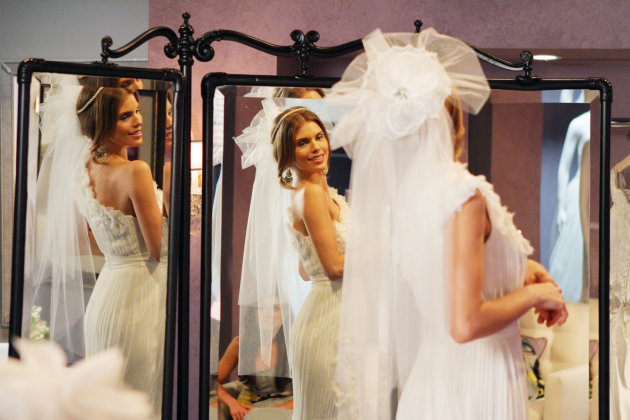 Admiring-her-gown