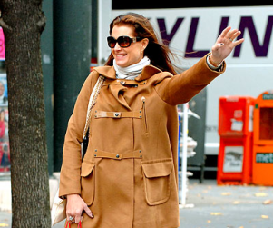 Brooke Out Smiling and Hailing a Cab