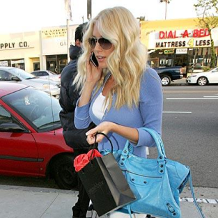 Heidi Montag Looks Fake, Places Call