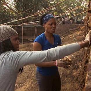 Jen and kisha plaster a wall