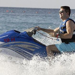 American Idol Picture of the Day: Simon Cowell Rides the Surf