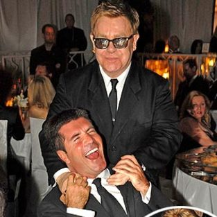 American Idol Picture of the Day: Simon Cowell Embraced by Elton John