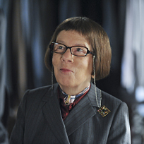 Linda Hunt as Henrietta Lange