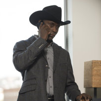 Lance Reddick as The Cowboy