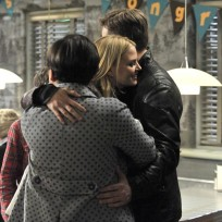 Emma Hugs Her Parents