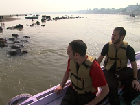 Zev and Justin Ride In a Boat