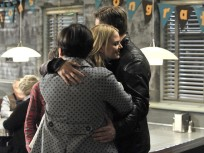 Emma Hugs Her Parents