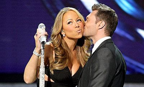 Ryan Seacrest Smooches Mariah Carey