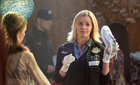 Elisabeth Shue with a Shoe