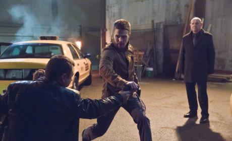 Oliver Takes Down a Baddie