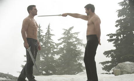 """Arrow Stars Tease """"Scary"""" Midseason Finale, Shirtless Fight Scenes... and a Baby?"""