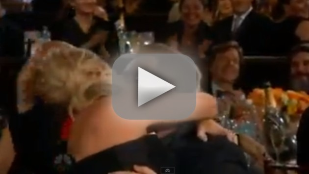 Amy Poehler Kisses Bono at Golden Globs