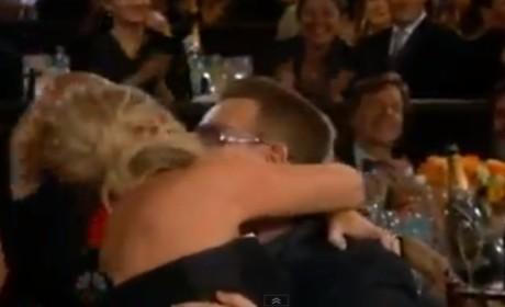 Amy Poehler Kisses Bono at Golden Globs